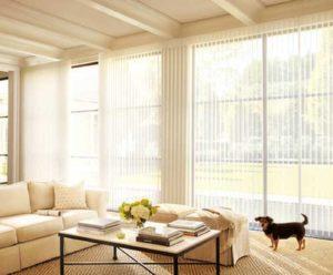 white shutter windows installed in living room