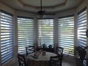 dining area with shutter windows